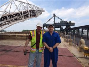 Second mate Dominic Gorno and Third assistant engineer Adam Saile on the deck of the American Mariner while loading coal.