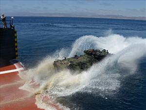 A Marine Corps Amphibious Assault Vehicle launches from the <i>USNS Montford Point</i>. U.S. Navy photo by MC2 Joshua Scott/Released