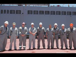 Members of American Maritime Officers working aboard the <i>USNS Montford Point</i> in June during operations with the <i>USNS Bob Hope</i> included Third Mate Tom Kozarski, Third Mate Gene Brown, Second Mate Joshua Jordan, Captain Michael Sands, Chief Engineer Joseph Gelhaus, First Assistant Engineer Michael Long, Third A.E. Chris Beaton, Second A.E. Joe Moore and Electronics Officer Timmy Cannon. The <i>USNS Montford Point</i> is operated for MSC by Ocean Ships, Inc.