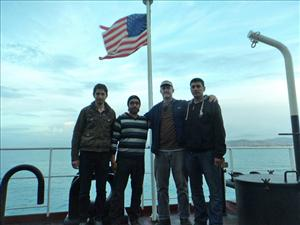 AMO member Third Mate Jeff Pearce greets three of the Syrian refugees onboard the <i>Liberty Grace</i>.