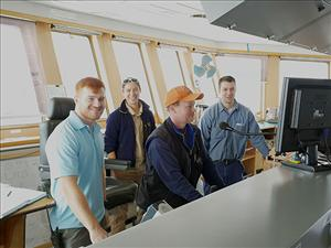 American Maritime Officers members working aboard the <i>C.S. Resolute</i> in August included Third Mate Tyler Reszoly, Third Mate Alysia Johnson, and Chief Mate Chris Gabrielson. With them is Cadet Doug Strassburg. Photo courtesy of Captain Eric Clark