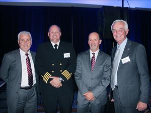 Greeting American Maritime Officers member Captain Raymond Thompson, prospective master on <i>Perla del Caribe</i>, at the ship's christening and launch ceremony in San Diego were (from left) AMO National Executive Vice President Robert Kiefer; TOTE, Inc. President and CEO Anthony Chiarello; and AMO National President Paul Doell.