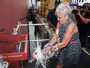Helen Downs christens the tanker <i>Lone Star State</i> at the General Dynamics NASSCO shipyard in San Diego, Calif. Photo: General Dynamics NASSCO