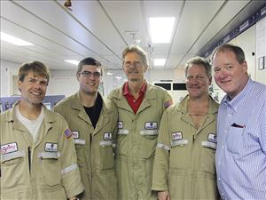 AMO members working aboard the tanker <i>Ohio</i> in November, here in Tampa, Fla., included Chief Engineer Don Routly, First Assistant Engineer Ron Bernhardt, Second A.E. Michael Nowicki and Third A.E. Keith Nelson. With them is AMO National Vice President, Inland Waters, Dave Weathers.