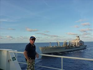 American Maritime Officers member Captain Everett Hatton, master on the <i>Maersk Peary</i>, observes the approach of the MSC underway replenishment oiler <i>USNS Rappahannock</i>. Photo courtesy of <i>Maersk Peary</i>