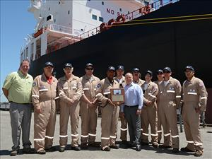American Maritime Officers members working aboard the Jones Act tanker <i>Louisiana</i> May 5, here in New Orleans at the ship's christening ceremony, included (in no particular order) Captain Calvin Patterson, Captain Scott Davis, Chief Engineer Daniel Savoie, Chief Engineer James Gushee, Chief Mate Michael Stutevoss, Chief Mate Scott Payne, First Assistant Engineer Eric Dobbin, Second Mate Peter Guggina, Third Mate Kyle Demonterey and Third Mate Joseph Martinet. With them are Crowley Chairman and CEO Tom Crowley and AMO National Vice President, Inland Waters, David Weathers. Not in the picture are Second A.E. Matthew Hurd and Third A.E. Daniel Figge.