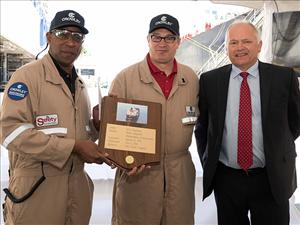 Philly Shipyard President and CEO Steinar Nerbovik presents Captain Calvin Patterson and Captain Scott Davis with the ship's plaque for the Jones Act tanker <i>Louisiana</i> during the christening ceremony.