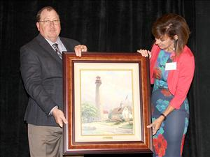 Yvette Romasko, sponsor of the <i>Garden State</i>, presents a painting as a gift for the ship to Captain Robert Cates before the ship's christening on May 7.