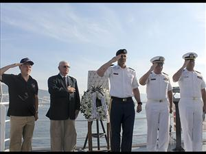 From left to right, Captain Glenn Macario, Mr. Walt Christensen, Col. Ted Stephens, Lt. Cmdr. Mike Pugh and Chaplain Zachary Zumwalt on the <i>USNS Wheeler</i>'s starboard bridge wing at the start of the ceremony - The <i>USNS Wheeler</i> hosted the Maritime Day wreath laying in Busan, Korea on May 20, 2016. Photos courtesy of Captain Glenn Macario
