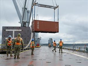 Members of U.S. Navy Amphibious Construction Battalion 1 transferred 150 containers of relief cargo from the <i>USNS Bob Hope</i> to military lightering barges, which were also transported to the Puget Sound onboard the ship. The cargo was brought ashore on Indian Island to conduct disaster recovery exercises for Cascadia Rising.