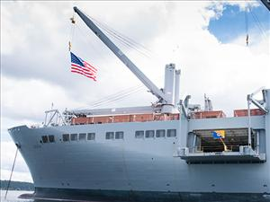 The <i>USNS Bob Hope</i> flies the ship's battle flag and the Military Sealift Command flag on Memorial Day. Photo courtesy of Captain Robert Silva