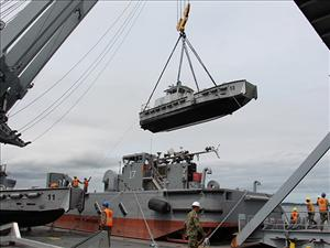 A military utility boat is lifted from the deck of the <i>USNS Bob Hope</i> and deployed in the water for JLOTS 2016. Photo courtesy of Military Sealift Command