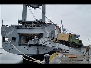 Military rolling stock is offloaded on Indian Island for JLOTS 2016. Photo courtesy of Captain Robert Silva