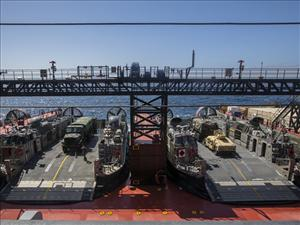 Two Landing Craft Air Cushions are parked aboard the <i>USNS John Glenn</i> at sea near Camp Pendleton, Calif., July 11, 2016. 1st Truck Support Battalion, in conjunction with U.S. merchant mariners, rehearsed the offloading of vehicles during a skin-to-skin maneuver for the PACOM Amphibious Leaders Symposium (PALS) demonstration. (U.S. Marine Corps photo by Lance Cpl. Danny Gonzalez)