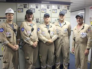 American Maritime Officers members working aboard the <i>West Virginia</i>, here in the ship's engine room in Philadelphia on August 16, included (in no particular order) Chief Engineers Daniel Savoie and Evan Park, First Assistant Engineer Daniel Figge, Second A.E. James Brown and Third A.E. Thomas Millett.