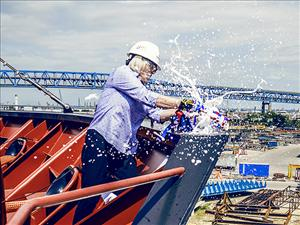 Anne Swearingen, the sponsor of the <i>West Virginia</i>, christens the ship in Philadelphia on August 16. Anne is the wife of John Swearingen, senior vice president, Marathon Petroleum Corporation.