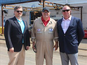 AMO National Assistant Vice President, Government Relations, Christian Spain and AMO East Coast Representative Todd Christensen greet Captain Scott Davis, master on the <i>West Virginia</i>, at the ship's christening ceremony August 16.