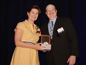 Captain Greg Wallace presents Cristin Thorogood, sponsor of the <i>Constitution</i>, with a Chelsea Clock on behalf of SEA-Vista at a luncheon prior to the ship's christening and launch.