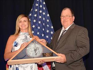 Captain Robert Cates presents the sponsor of the <i>Bay State</i>, Melissa DeVeau, with a gift from American Petroleum Tankers following the ship's christening.