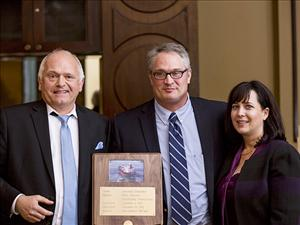 President and CEO of Philly Shipyard Steinar Nerbovik, Captain Scott Davis and Lisa McCord, sponsor of the <i>American Endurance</i>, gather for the presentation of the ship's plaque.