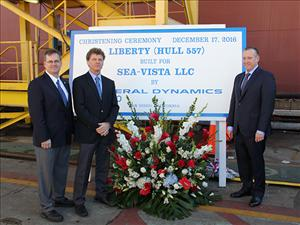 Chief Engineer Marc Lenzi (second from left) and Captain Paul Johnson (right) with AMO West Coast Representative William Barrere at the christening of the <i>Liberty</i> in San Diego, Calif.