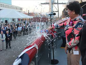 Vessel Sponsor Cornelia Peterson christens the <i>Trident</i>.