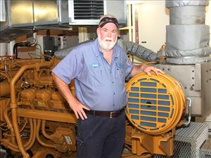 Chief Engineer Robert Santos in the engine room of the Advanced Rotortug <i>Trident</i> - American Maritime Officers represents the crew aboard the Seabulk Towing vessel.