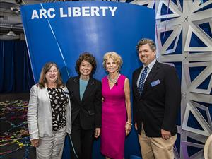 Greeting U.S. Secretary of Transportation Elaine Chao and First Lady of South Carolina Peggy McMaster, the sponsor of the <i>M/V Liberty</i>, were AMOS Legislative Consultant Brenda Otterson and AMO National Assistant Vice President Christian Spain.