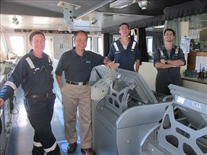 American Maritime Officers members working aboard <i>M/T Maersk Michigan</i> in February included Chief Mate Karen Laycock, Captain Thua Pham, Third Mate Joseph Severson and Second Mate William Harris. Photos courtesy of Captain Thua Pham