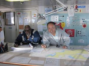 American Maritime Officers members working aboard <i>M/T Maersk Michigan</i> in February included Second Mate Wayne Archer and Captain Thua Pham.