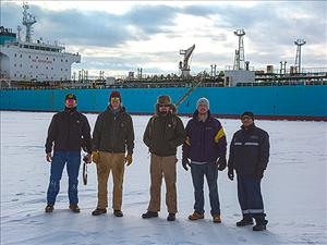 AMO members working aboard the <i>Maersk Peary</i> during Operation Deep Freeze 2018 included Second Assistant Engineer Loren Anderson, Third Mate Michael Watkins, Chief Engineer James Cook and Third Mate Will McDermott, here in front of the ship awaiting berthing. With them is SIU member Wiper Felix Lugo.