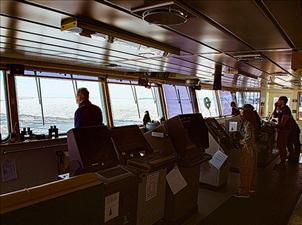 The bridge crew on the <i>Maersk Peary</i> follows the course cleared by the Coast Guard ice breaker <i>Polar Star</i> during Operation Deep Freeze 2018.