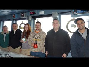 Members of American Maritime Officers working aboard the <i>USNS Pathfinder</i> in March included Radio Officer Reid Griffin, Captain Mel Santos, Third Mate Mikaela Cameron, Third Mate Fintan (Fin) Moore, Chief Mate Kyle Dupuis and Second Mate Christopher Ruggiero. <i>Photos courtesy of Captain Mel Santos</i>