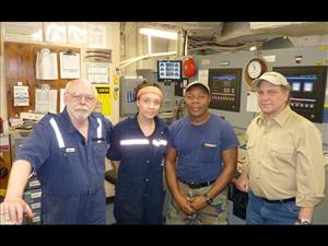 AMO members working aboard the <i>USNS Pathfinder</i> in March included First Assistant Engineer Chipper Lee, Third A.E. Robyn Plocinski, Second A.E. Armando (Chava) Bermudez and Chief Engineer Michael Hadley. The <i>USNS Pathfinder</i> is operated for Military Sealift Command by Ocean Shipholdings, Inc.