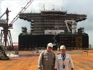 On the deck of the <i>USNS Montford Point</i> during the dry-docking are Chief Engineer Joe Gelhaus (Ocean Ships, Inc. assistant port engineer) and OSI Port Engineer Bill Dennis. The <i>USNS Montford Point</i> serves in Military Sealift Command's Prepositioning Program (PM3).
