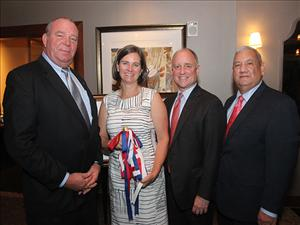 AMO East Coast Representative Todd Christensen and Seafarers International Union Executive Vice President Augie Tellez greet Crowley Chairman and CEO Tom Crowley and his wife, Christine, the sponsor of <i>El Coqu&#237;</i>, at the sponsor dinner on October 19, 2018.
