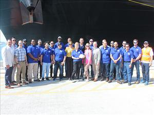 The entire crew of the <i>M/V Taíno</i> gather for a photo with Crowley Chairman and CEO Tom Crowley and his daughter and ship sponsor, Clara. AMO represents all licensed officers on the Commitment Class vessel and the Seafarers International Union represents the unlicensed crewmembers.