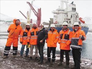 Members of American Maritime Officers working aboard the <i>SLNC Magothy</i> during Operation Deep Freeze 2020, here as the ship docked at McMurdo Station, Antarctica, included Third Mate Chris Cudney, Chief Mate Louis Hartmann, Captain Eric Swanson, Chief Mate Kraig Wallace, First Assistant Engineer Matt Fuss, Third Assistant Engineer Jack Watkins and Chief Engineer James Brown. The <i>SLNC Magothy</i> is operated under Military Sealift Command charter by Argent Marine Operations and is manned in all licensed positions by AMO.